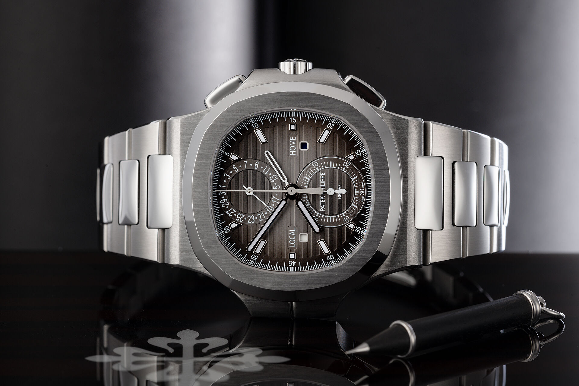 ref 5990/1A-001 | Box & Papers | Patek Philippe Nautilus Travel Time Chronograph