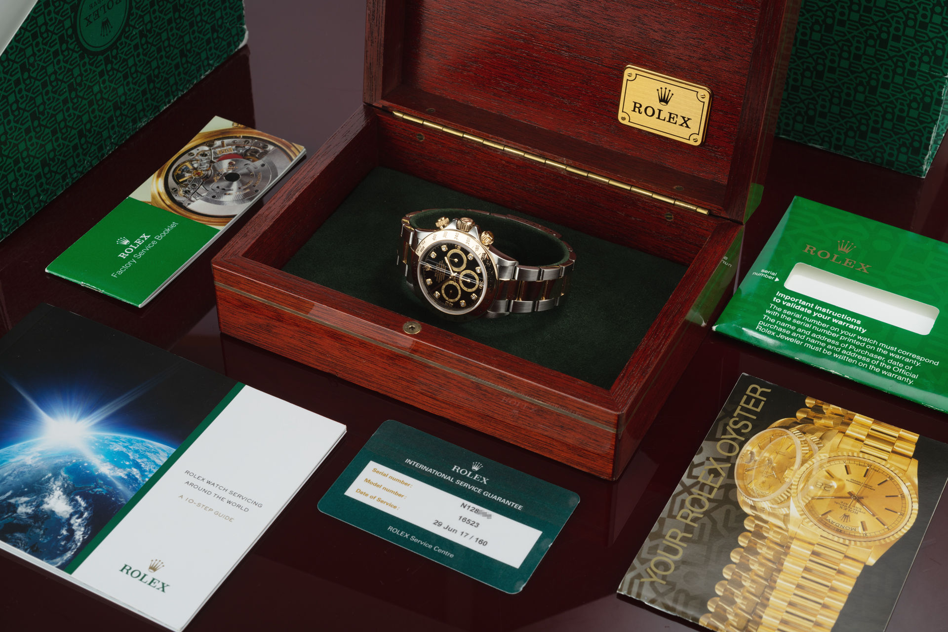 ref 16523 | Gold & Steel 'Upside Down Six' Rolex Warranty | Rolex Cosmograph Daytona